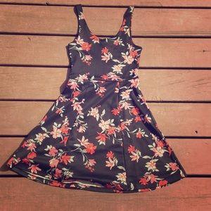 A thigh length black floral dress